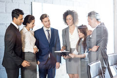 Businesspeople interacting in conference room Stock Photography