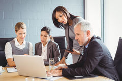 Businesspeople interacting in conference room Royalty Free Stock Photos