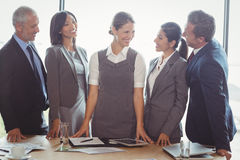 Businesspeople interacting in conference room Royalty Free Stock Photography