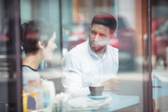 Businesspeople interacting while having coffee. In office Stock Photo