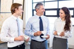 Businesspeople interacting in office during breaktime Royalty Free Stock Photo