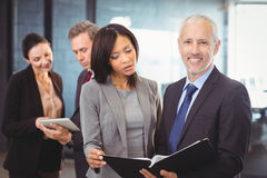 Businesspeople interacting in the office Royalty Free Stock Image