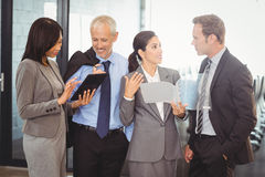 Businesspeople interacting in office Royalty Free Stock Photos
