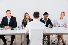 Businesspeople Interviewing Man Royalty Free Stock Photo
