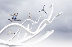Businesspeople jumping. Young businesspeople jumping on white arrows. Growth concept Stock Photo