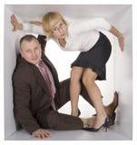 Businesspeople in kubus royalty-vrije stock fotografie