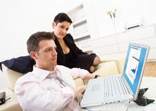 Businesspeople with laptop Stock Photos