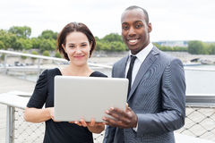 Businesspeople on laptop Stock Images