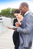 Businesspeople on laptop, outdoors Stock Images