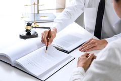 Businesspeople or lawyer having team meeting discussing agreement contract documents, judge gavel with Justice lawyers at law fir stock images