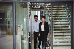 Businesspeople leaving office. Businesspeople interacting with each other while leaving office Stock Photography