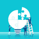 Businesspeople with light bulb Stock Images