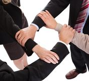 Businesspeople linking hands - teamwork Stock Photo