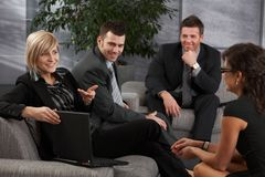 Businesspeople listening to businesswoman Stock Photos