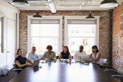 Businesspeople Listening To Presentation In Boardroom Stock Photos