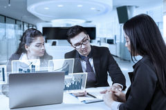 Businesspeople look at business contract Stock Photography