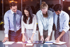 Businesspeople looking at document Stock Photography