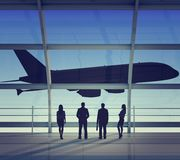 Businesspeople looking at jet Stock Image