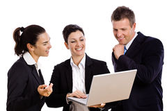 Businesspeople looking at laptop Stock Image