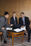 Businesspeople Looking at Laptop Stock Photo
