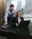 Businesspeople Looking at Laptop Computer Stock Photos