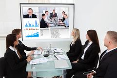 Businesspeople looking at projector screen Royalty Free Stock Image