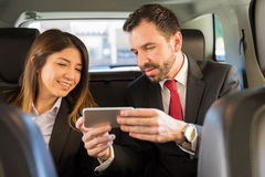 Businesspeople looking at a smartphone Stock Image