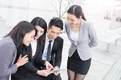 Businesspeople looking tablet and meeting. Businesspeople are looking tablet pc and meeting in hongkong, asian stock photography