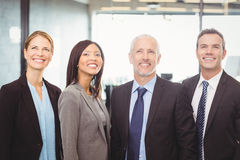 Businesspeople looking up and smiling Stock Photo