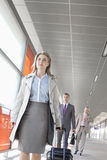 Businesspeople with luggage walking on train platform Royalty Free Stock Photography