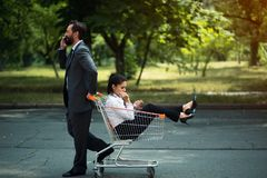 Business woman sitting in cart stock photography