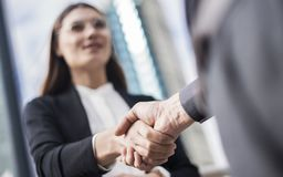 Businesspeople making hand shake in the city stock image
