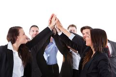 Businesspeople making high five gesture Stock Photo