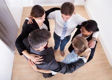 Businesspeople making huddle Stock Image