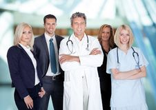 Businesspeople and medical workers Stock Images