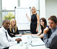 Businesspeople in a meeting. International businesspeople in a meeting looking at the camera stock photo