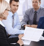 Businesspeople at meeting stock photo