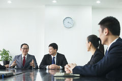 Businesspeople at a Meeting Stock Photos