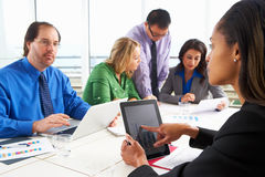 Businesspeople Meeting In Boardroom Royalty Free Stock Images