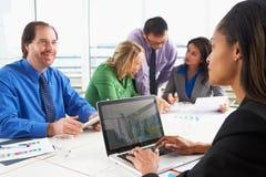 Businesspeople Meeting In Boardroom Stock Photos