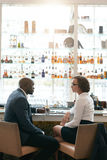 Businesspeople meeting at cafe after work Royalty Free Stock Photos