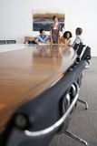 Businesspeople In Meeting At End Of Conference Table Stock Photography
