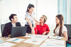 Businesspeople in meeting. Group of businesspeople having discussion on business report in the meeting stock photos