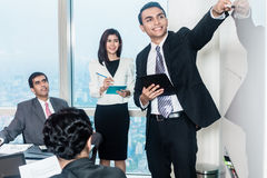 Businesspeople in meeting listening to presentation stock photo