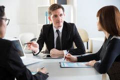 Businesspeople in a meeting. At office stock photography