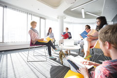 Businesspeople in meeting at office stock images