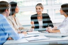 Businesspeople in a meeting at office. Group of happy business people in a meeting at office Royalty Free Stock Image
