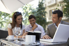 Businesspeople Meeting At Outdoor Cafe Stock Photo