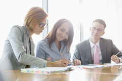 Businesspeople in meeting room royalty free stock photography