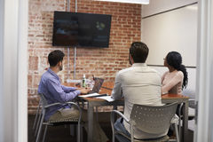 Businesspeople In Meeting Room Looking At Screen Royalty Free Stock Photography